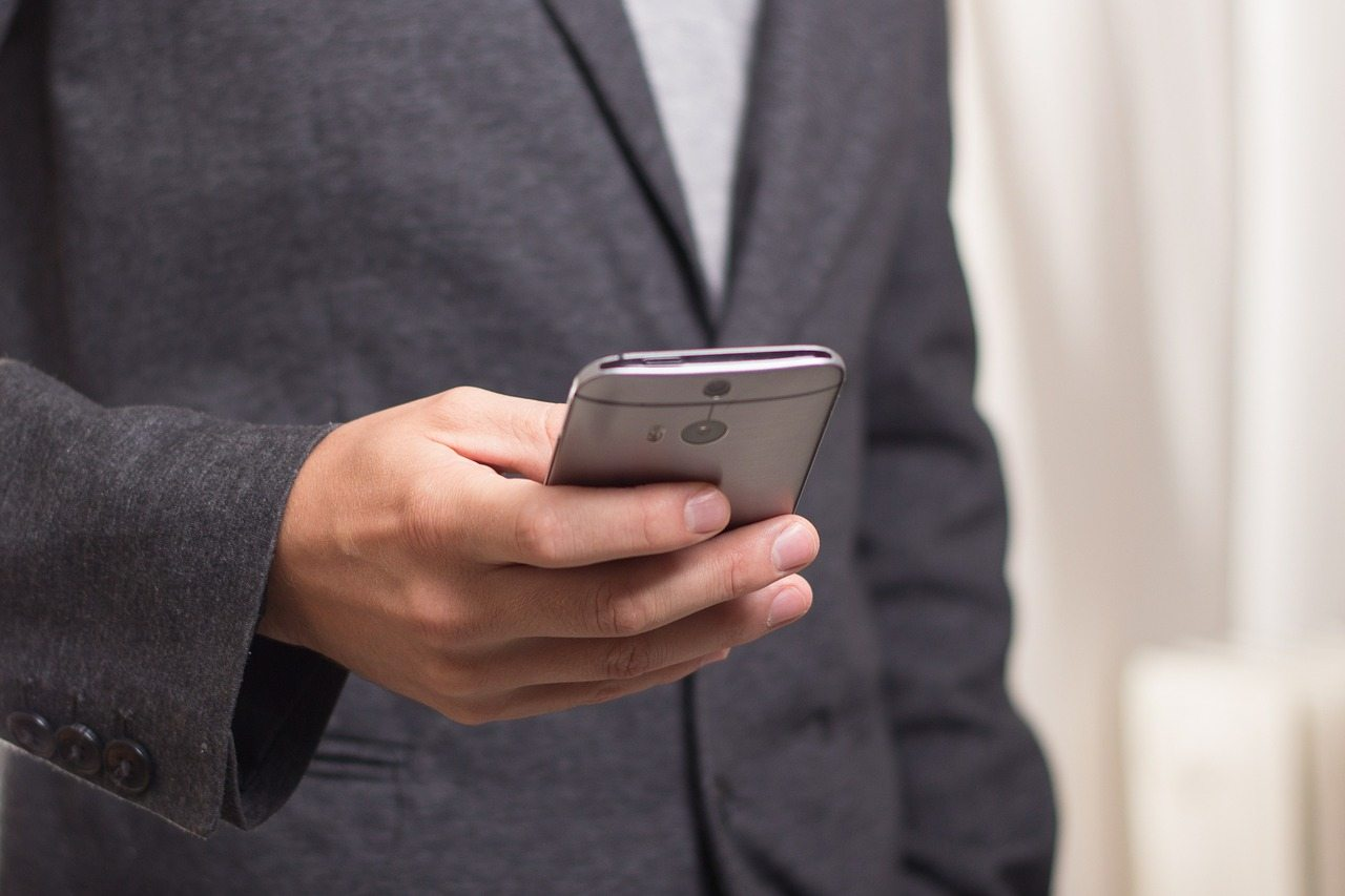 young professional holding a smartphone