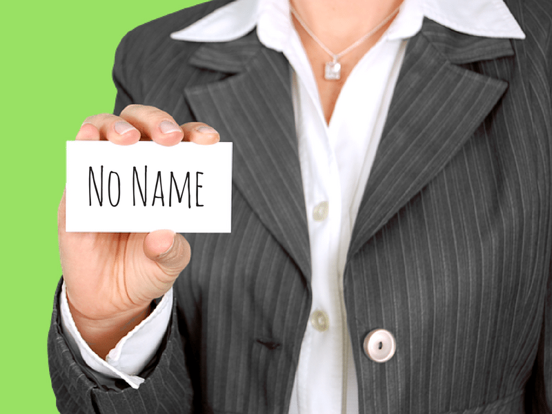 woman holding a card that says no name