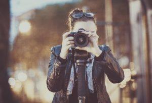 photograph of a woman taking a photo headon