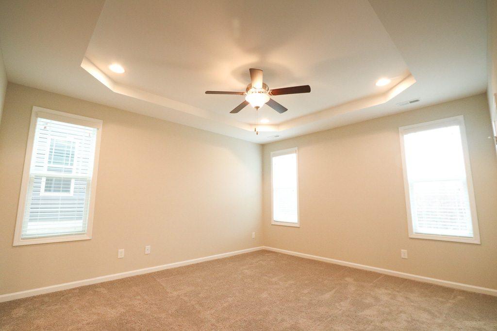 bedroom taken at a corner angle to make room look larger.